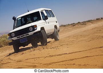 Speeding car - car speeding fast in the desert