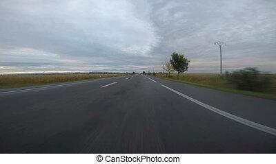 Speeding car on the highway
