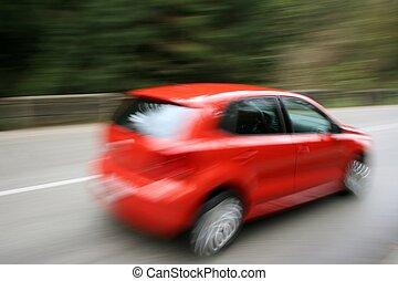 speeding car - speeding red car, blurred by motion