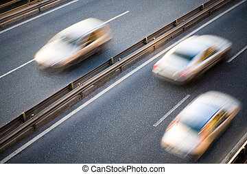 cars running speed on road in two directions