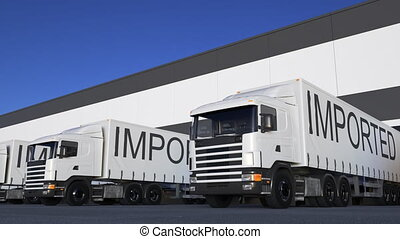 Speeding freight semi truck with IMPORTED caption on the...