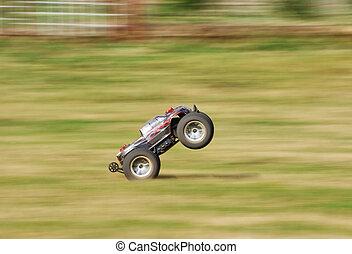 Speeding RC car on the grass
