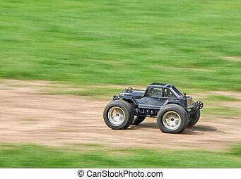 Speeding RC car - Speeding radio controlled car on the...