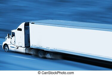 Speeding Semi Truck on the Highway. Blue Color Grading with...