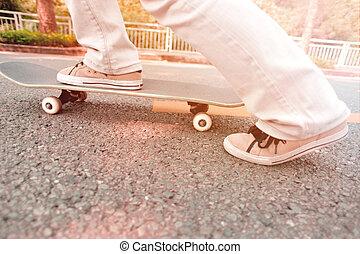 speeding skateboarding woman at city