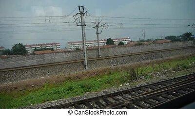 Speeding train travel,scenery outside window.train-station.