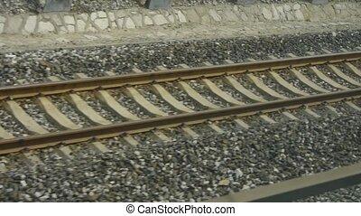 Speeding train travel,scenery outside window.train-station rail.