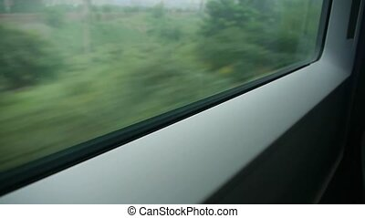 Speeding train travel,scenery outside window.Villages plains tree farmland.