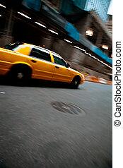 Speeding Yellow City Taxi Cab