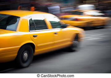 Speeding Yellow Taxi Cabs Motion Blur