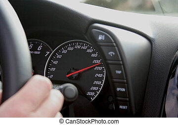 speedometer at 210 km/h - closeup to speedometer while car...