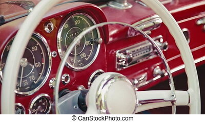 Speedometer of a red old-timer car - Dashboard of a red Old-...