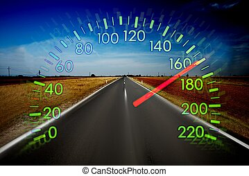 Speedometer over a blurred road representing driving very ...