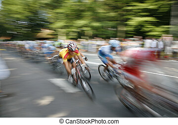 The cyclists riding by at the bicycle race Around Denmark