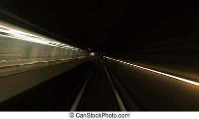 Speedy time lapse view from train cabin in tunnel, metro.