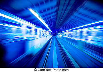 Speedy trains passing train station. Focus on the rail road.