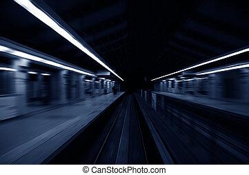 Speedy trains passing train station in monotone.