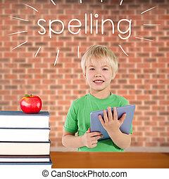 Spelling against red apple on pile of books