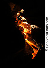 Spelunker exploring a cave