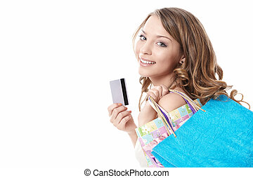 Spend money - A beautiful young girl with bags and credit...