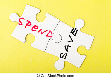 Spend or save - Spend and save words written on two pieces...