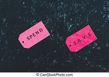 Spend vs Save texts on price tags, budgeting concept