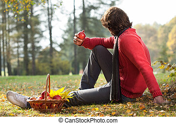 Spending free time - Young man spending free time in autumn...