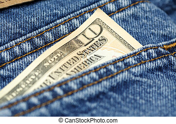 Spending money - A shot of a ten dollar bill on the back of...