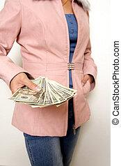 Spending money - A woman holding money