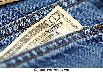 Spending money - A shot of a ten dollar bill on the back of...
