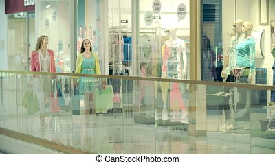 Spending Time and Money - Two ladies approaching camera...