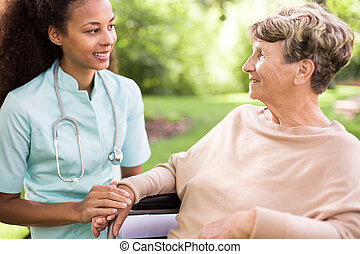Spending time in the garden - Senior woman and doctor ...
