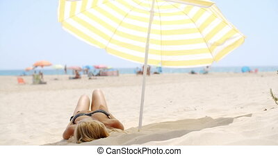 Spending Time on Sandy Beach under Umbrella on Slow Motion...