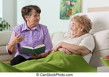 Spending time - Elderly woman spending time with her sick...