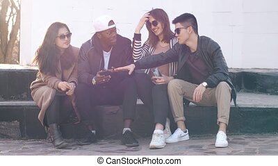 Spending time with friends - Group of multiethnic teenagers...