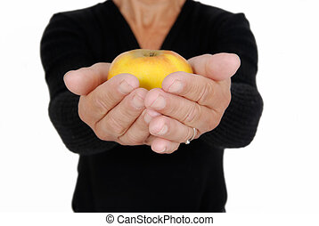 Spending - Two hands with an yellow apple