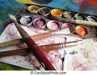 spent paintbox with brushes