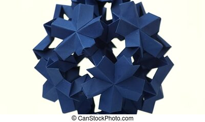 Sperical modular origami object. Close up blue origami ball...
