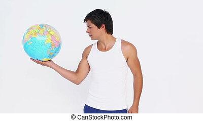 sphère, homme, tenant main