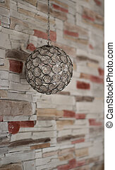 sphere lamp on texture stone wall background