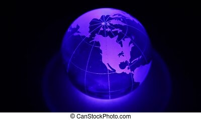 Sphere spins with world map on it and color illumination on...