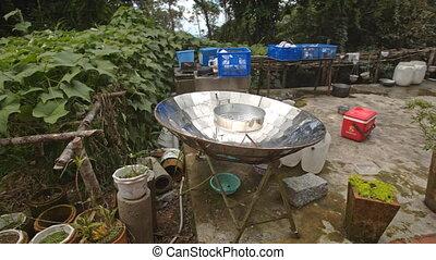 Spherical Mirror to Boil Water in House Yard in Vietnam