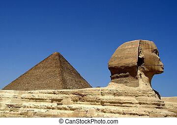 Sphinx near Pyramid in Egypt