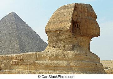 Sphinx statue and Pyramid in Giza Egypt. Ancient architecture