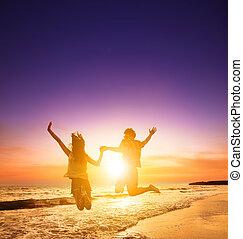 spiaggia, coppia, saltare, silhouette, giovane