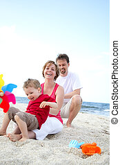 spiaggia, giovane famiglia, felice