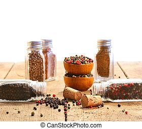 Spice glass containers on old wood table