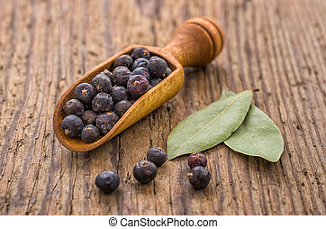 Spice scoop with juniper berries and bay leaves