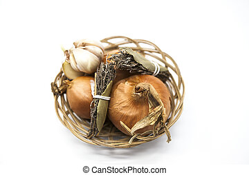 Spice set in wicker basket onion, Provence herbs, garlic on a white background.