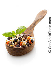 Spice mix a wooden spoon on a white background.
